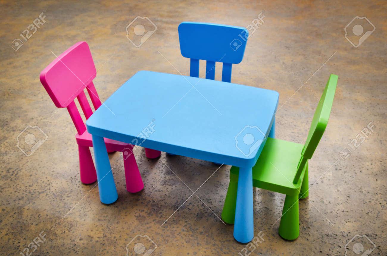 Kindergarten classroom table - Table And Three Chairs On Concrete Floor For Kindergarten Preschool Classroom Stock Photo 21583879