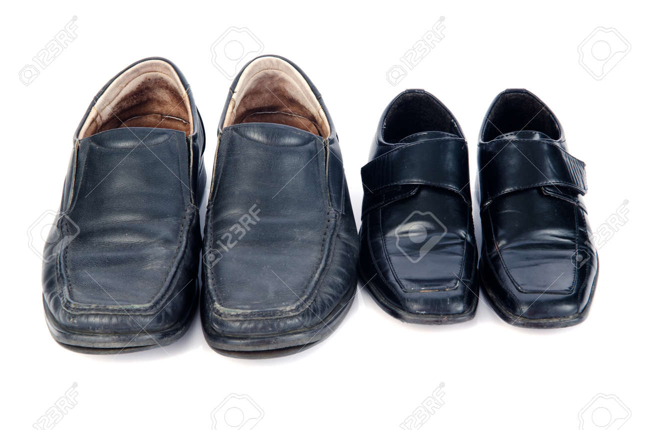 Old black shoes and shadow isolate on white. Stock Photo - 24394799