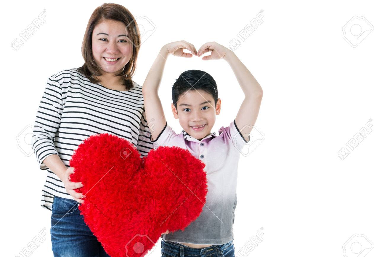 Happy asian mom and son hold big red heart on white background Stock Photo  - 35970461