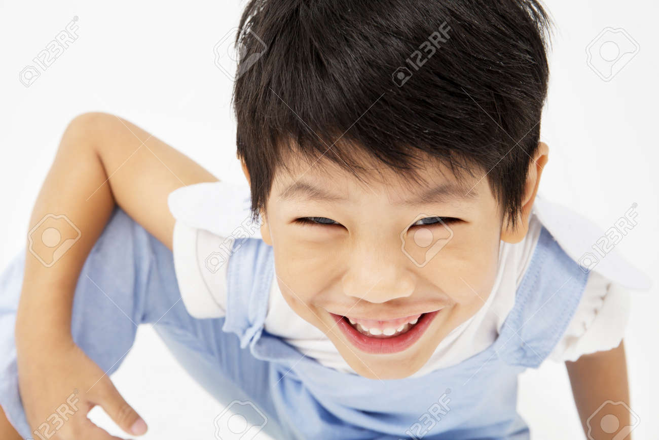 Happy asian cute boy with smile face on gray background - 66109982