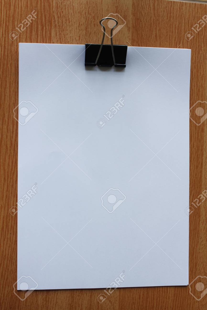 Paper clip on the background color. Stock Photo - 9922472