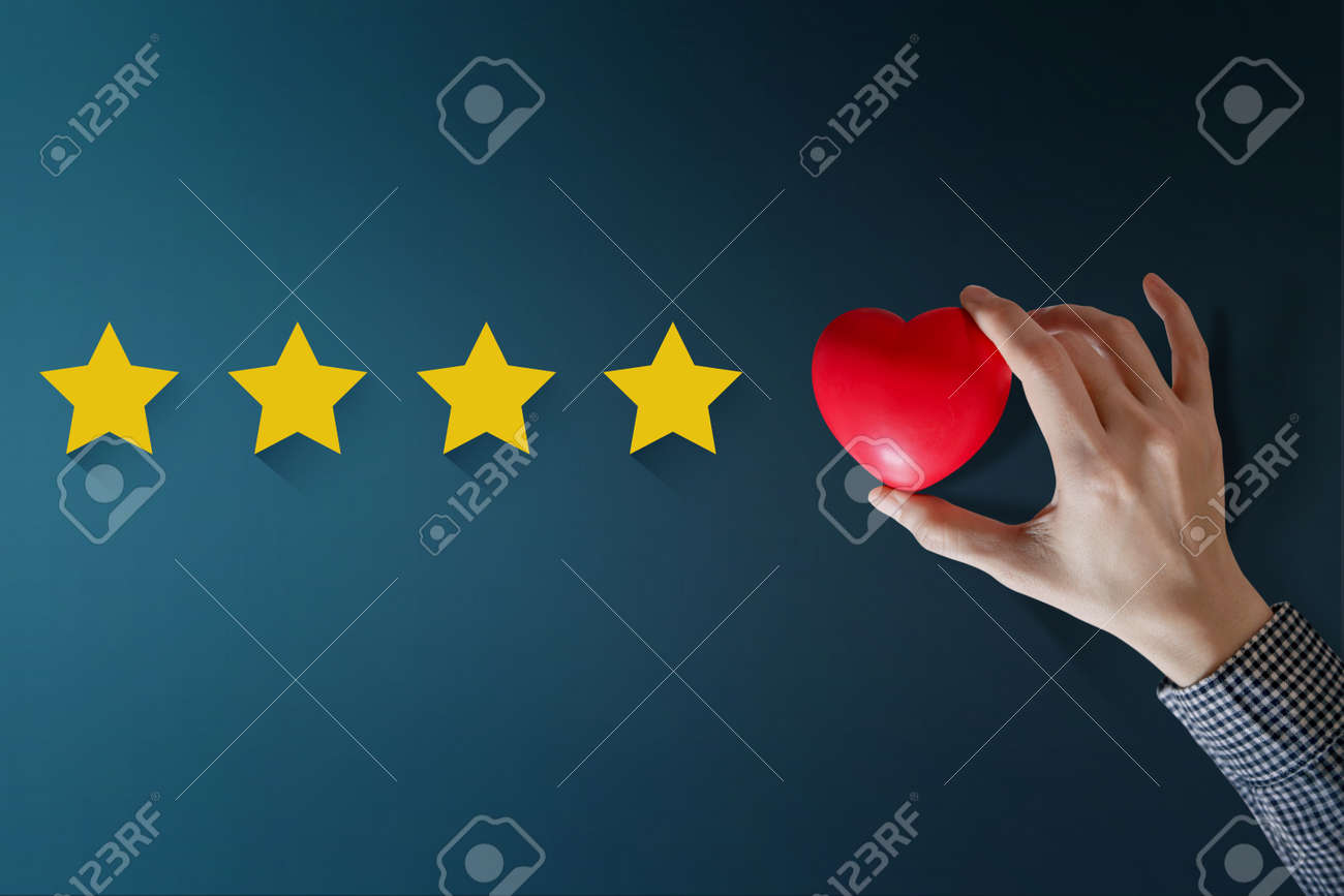 Customer Experience Concept, Best Excellent Services Rating for Satisfaction present by Hand of Happy Client put a Heart on Five Star - 88977892