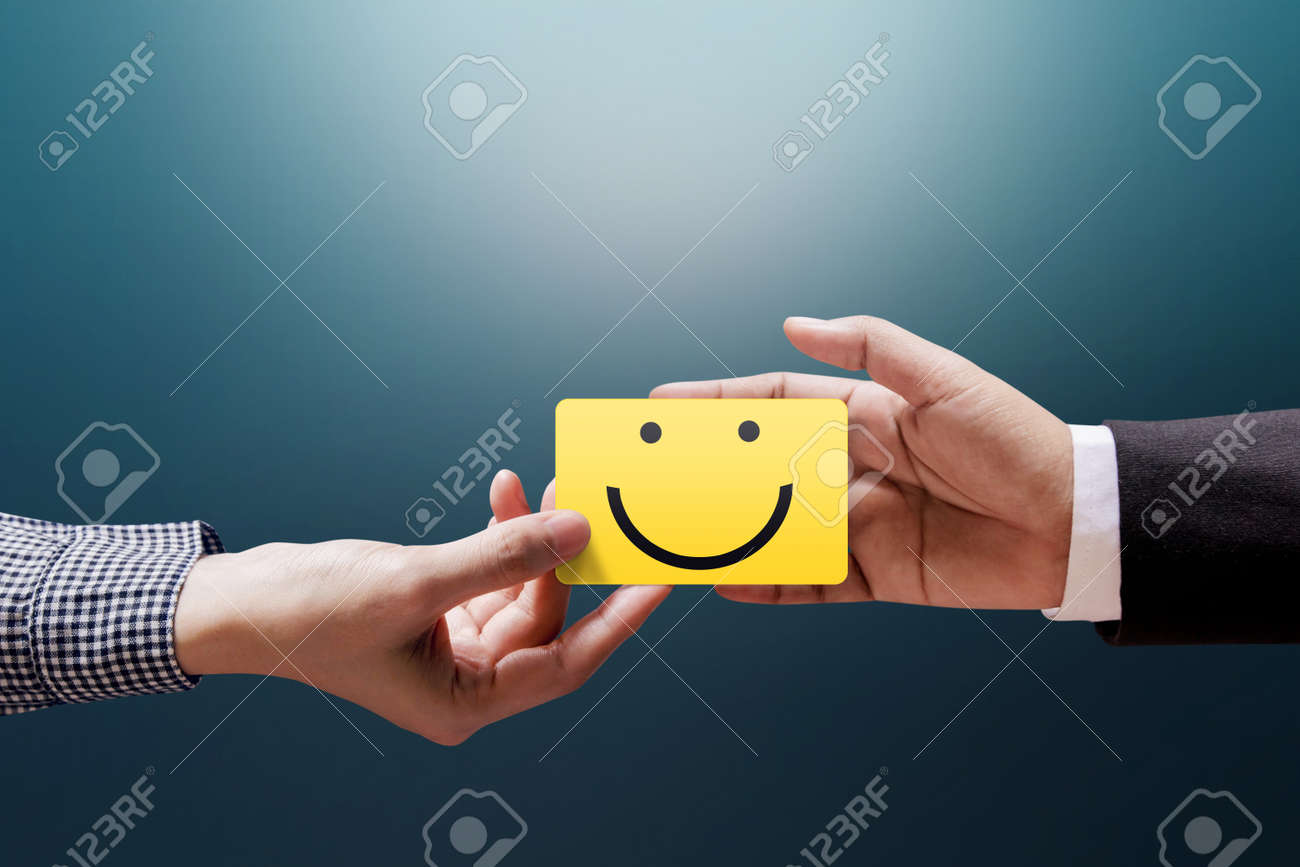 Customer Experience Concept, Happy Client Woman giving a Feedback with Happy Smiley Face Card into a Hand of Businessman - 92103675