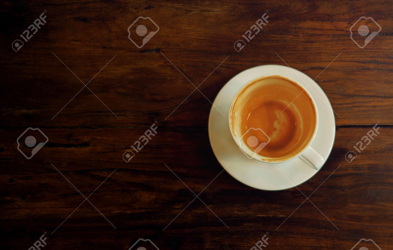 Coffee Cup on Wooden Table. Finished Latte or Cappuccino. Top View - 122907012