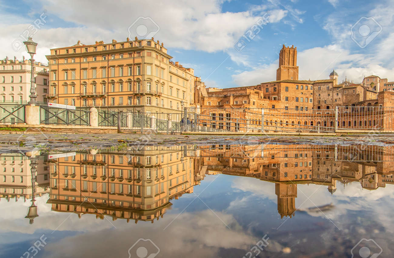 Rome, Italy - in Winter time, frequent rain showers create pools in which the wonderful Old Town of Rome reflect like in a mirror. Here in particular Via dei Fori Imperiali - 162677350