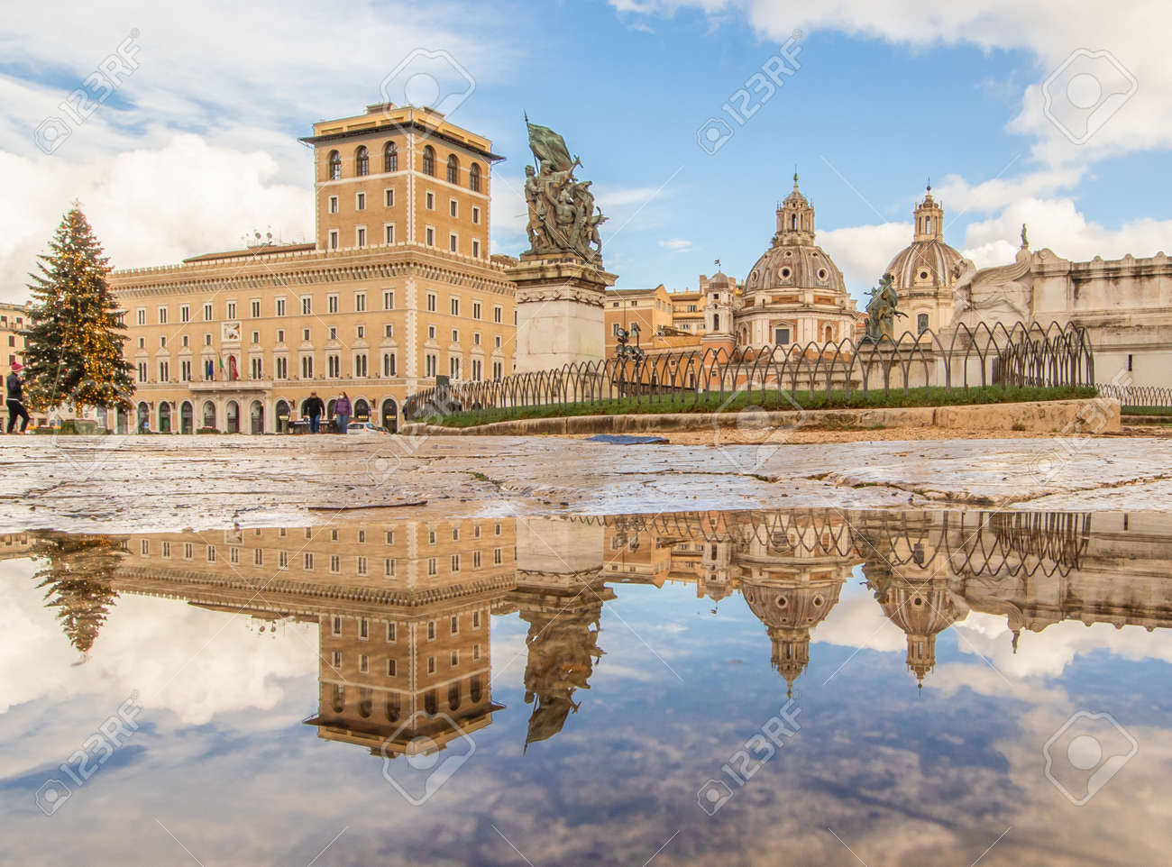 Rome, Italy - in Winter time, frequent rain showers create pools in which the wonderful Old Town of Rome reflect like in a mirror. Here in particular Via dei Fori Imperiali - 162677354