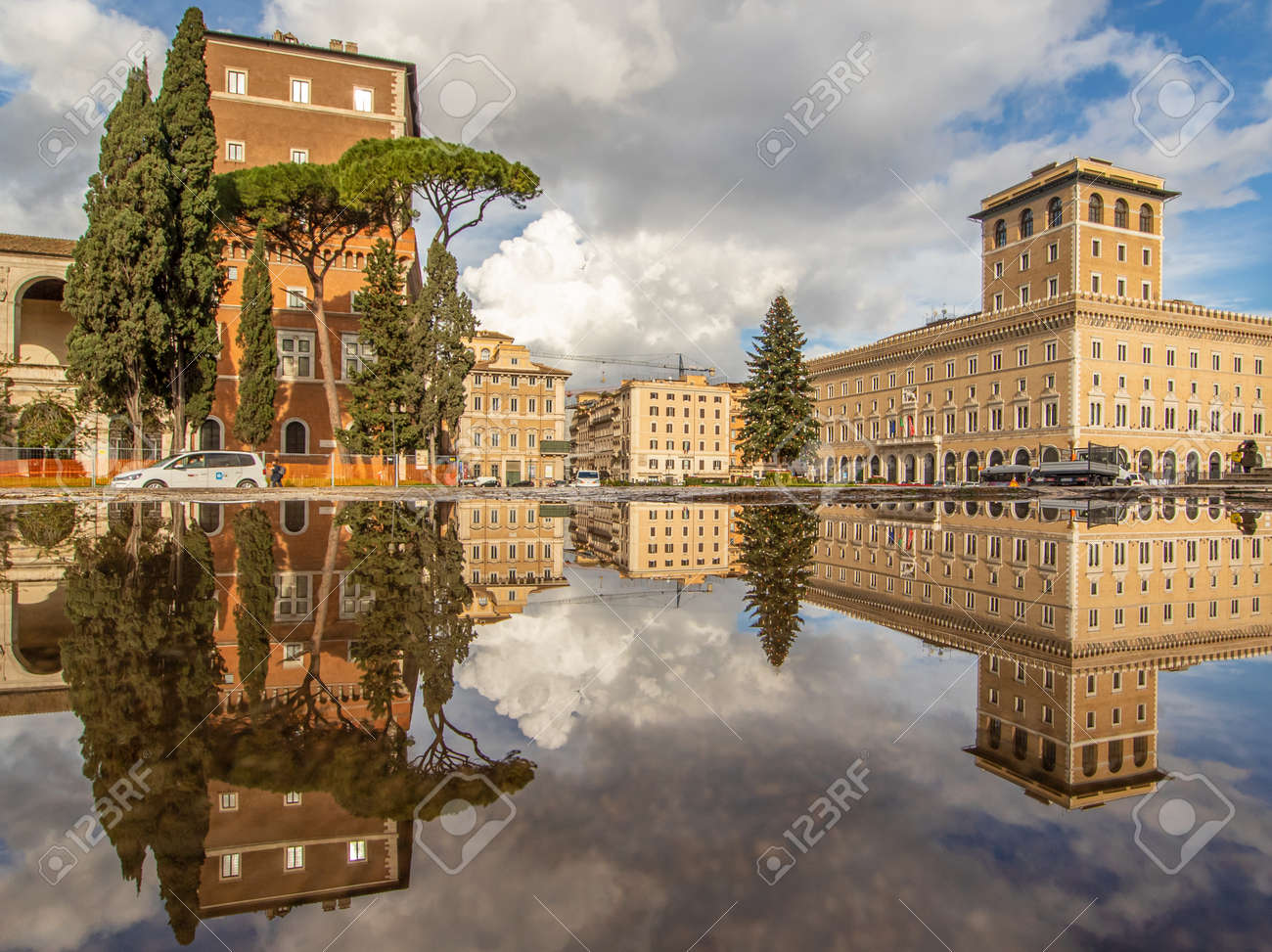 Rome, Italy - in Winter time, frequent rain showers create pools in which the wonderful Old Town of Rome reflect like in a mirror. Here in particular Via dei Fori Imperiali - 162677358