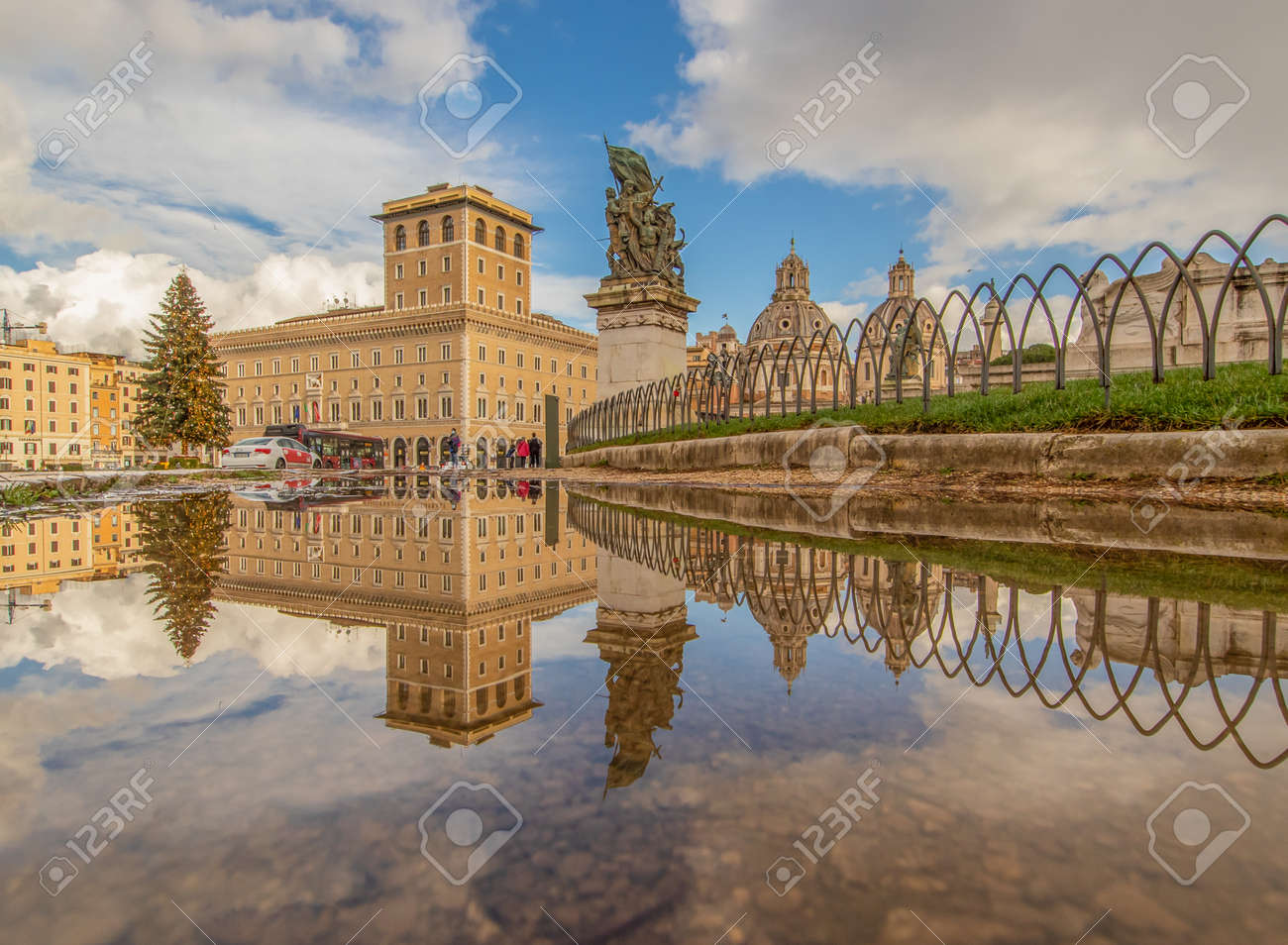 Rome, Italy - in Winter time, frequent rain showers create pools in which the wonderful Old Town of Rome reflect like in a mirror. Here in particular Via dei Fori Imperiali - 162677355