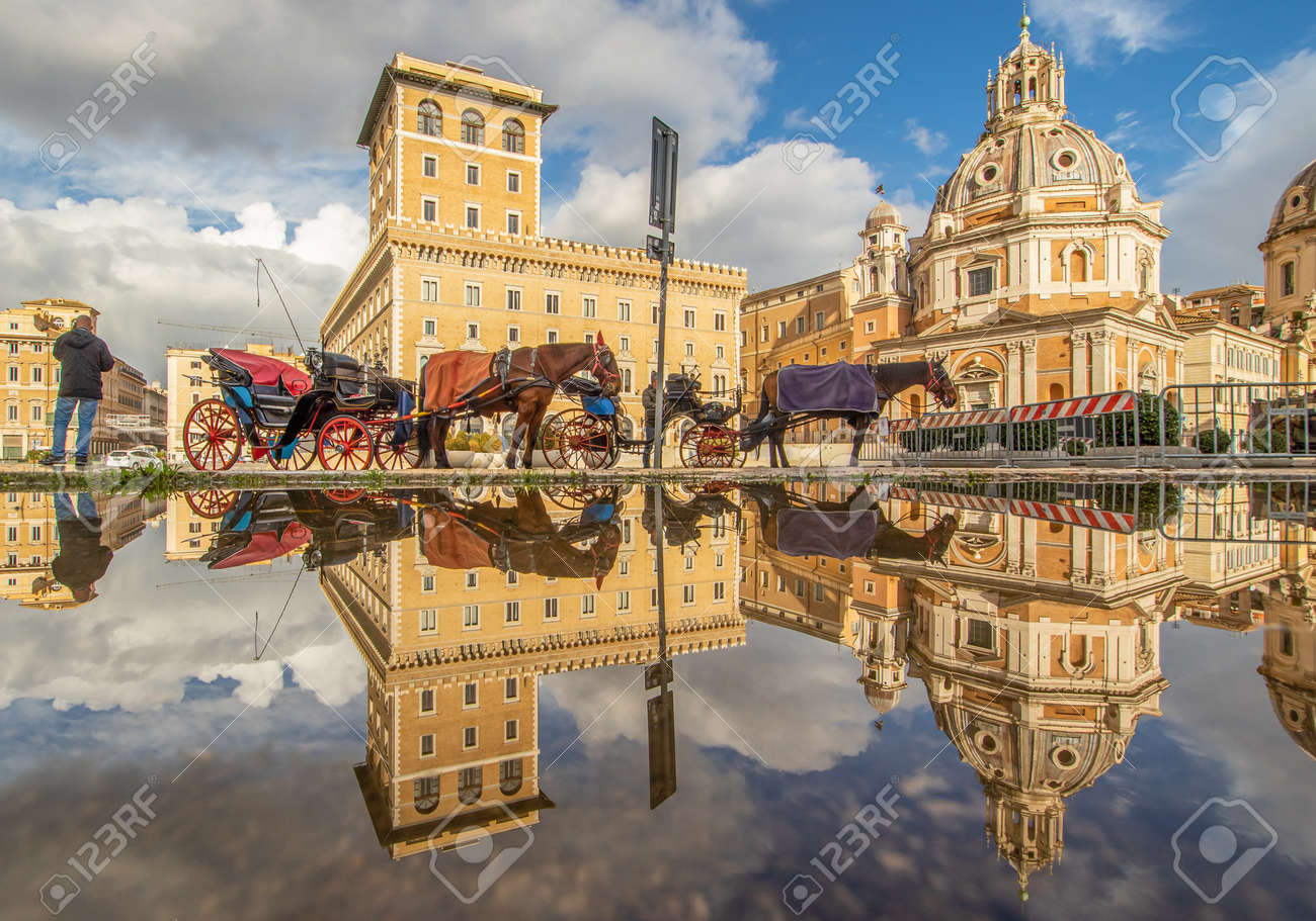 Rome, Italy - in Winter time, frequent rain showers create pools in which the wonderful Old Town of Rome reflect like in a mirror. Here in particular Via dei Fori Imperiali - 162677357