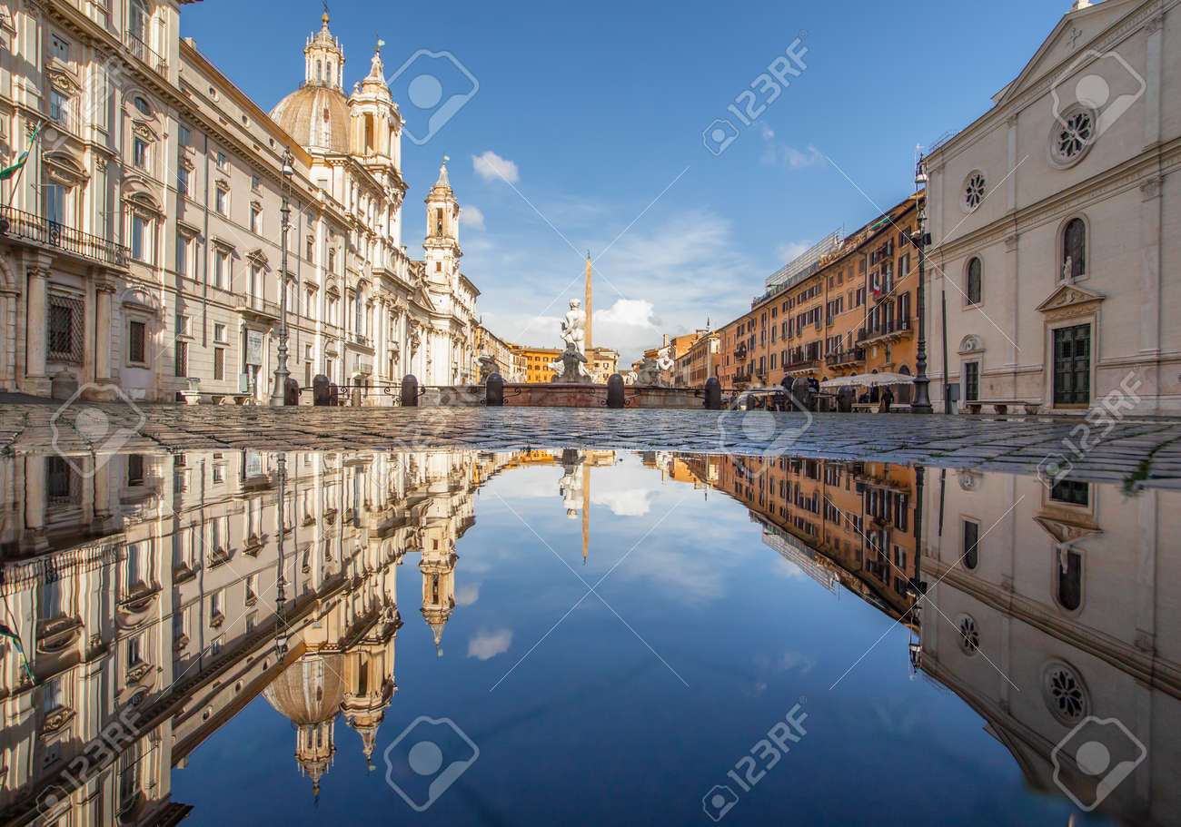 Rome, Italy - in Winter time, frequent rain showers create pools in which the wonderful Old Town of Rome reflect like in a mirror. Here in particular Piazza Navona - 163155409