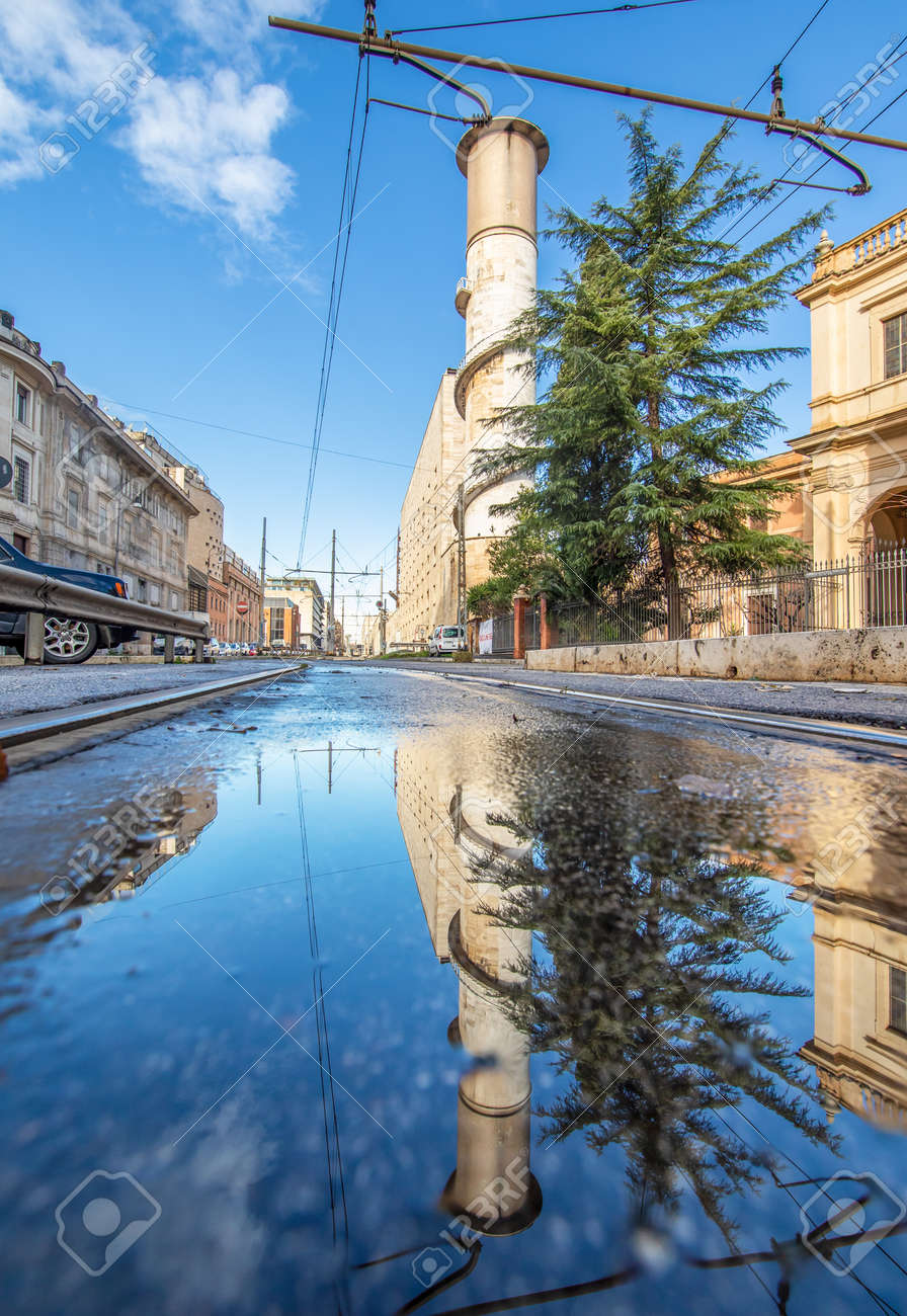 Rome, Italy - in Winter time, frequent rain showers create pools in which the wonderful Old Town of Rome reflects like in a mirror. Here in particular Via Giolitti - 163795071