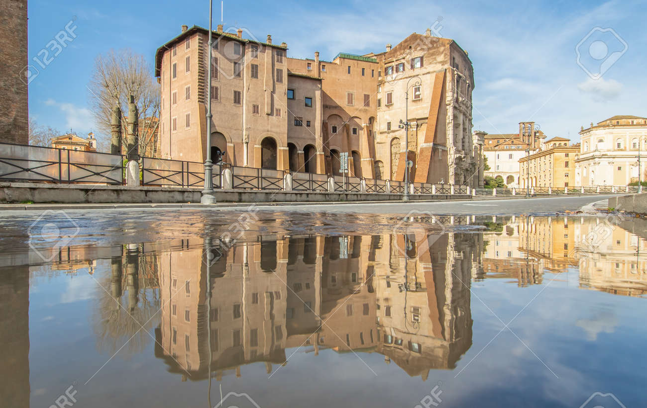 Rome, Italy - in Winter time, frequent rain showers create pools in which the wonderful Old Town of Rome reflects like in a mirror. Here in particular the Theater of Marcellus - 163759485
