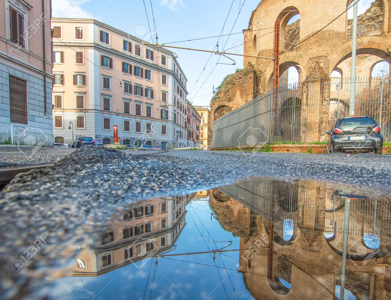 Rome, Italy - in Winter time, frequent rain showers create pools in which the wonderful Old Town of Rome reflects like in a mirror. Here in particular Via Giolitti - 163759496