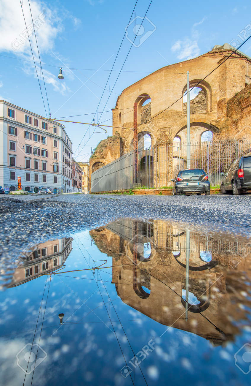 Rome, Italy - in Winter time, frequent rain showers create pools in which the wonderful Old Town of Rome reflects like in a mirror. Here in particular Via Giolitti - 163759521