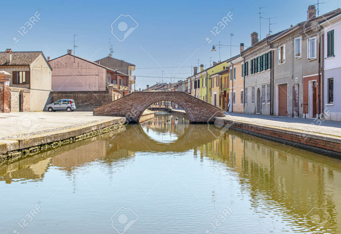 Comacchio, Italy - often compared to Venice for the canals and the architecture, Comacchio displays one of the most characteristic old towns in Emilia Romagna - 170448993