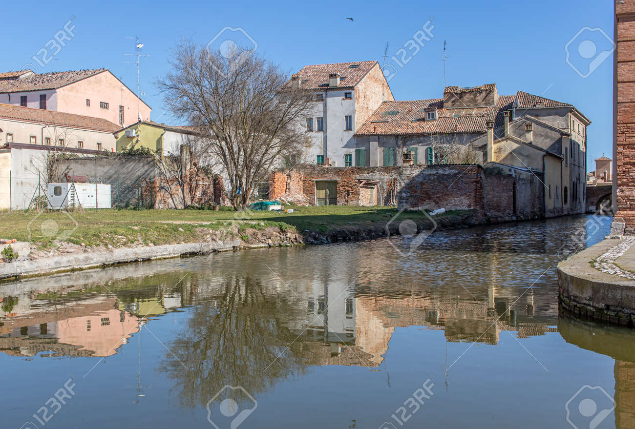 Comacchio, Italy - often compared to Venice for the canals and the architecture, Comacchio displays one of the most characteristic old towns in Emilia Romagna - 170448999