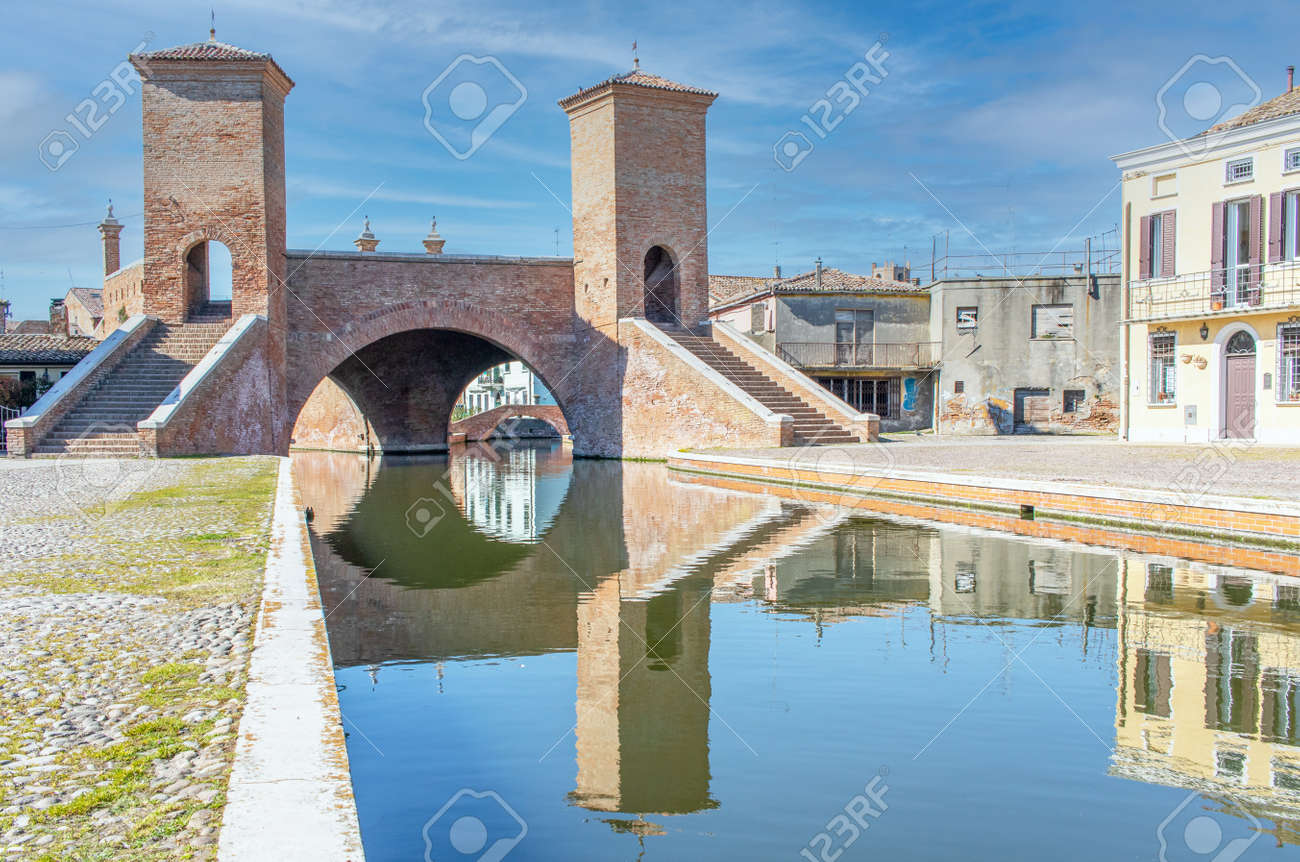 Comacchio, Italy - often compared to Venice for the canals and the architecture, Comacchio displays one of the most characteristic old towns in Emilia Romagna - 170490481