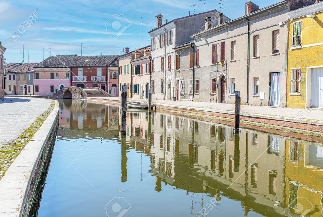 Comacchio, Italy - often compared to Venice for the canals and the architecture, Comacchio displays one of the most characteristic old towns in Emilia Romagna - 170490482