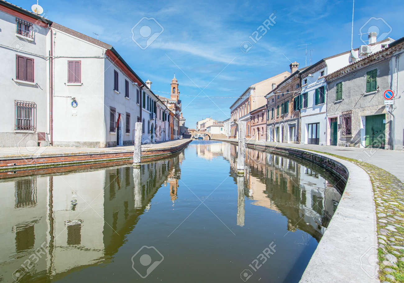 Comacchio, Italy - often compared to Venice for the canals and the architecture, Comacchio displays one of the most characteristic old towns in Emilia Romagna - 170490493