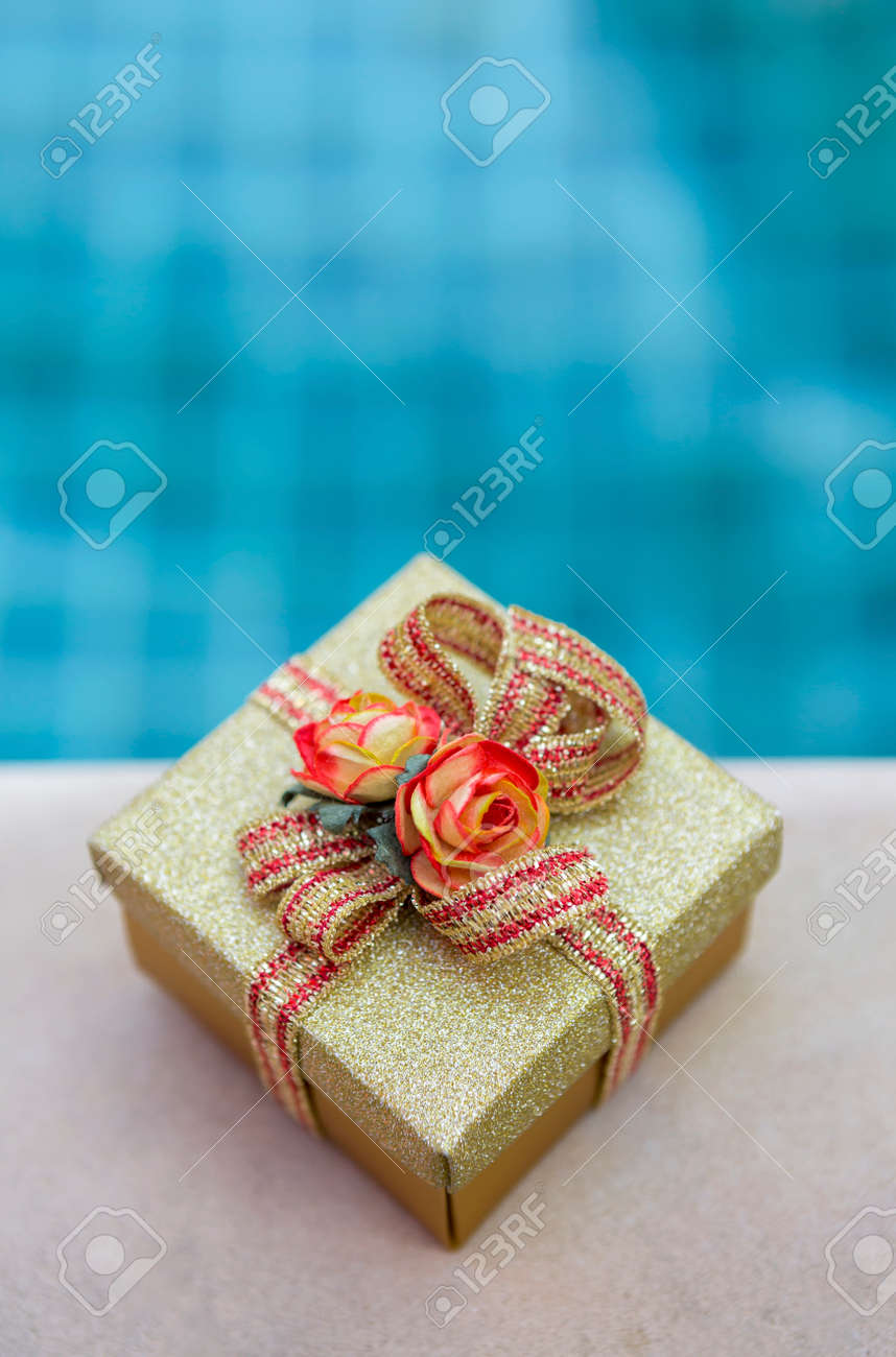 Christmas Gift Box With Swimming Pool Background Vertical Style Stock Photo