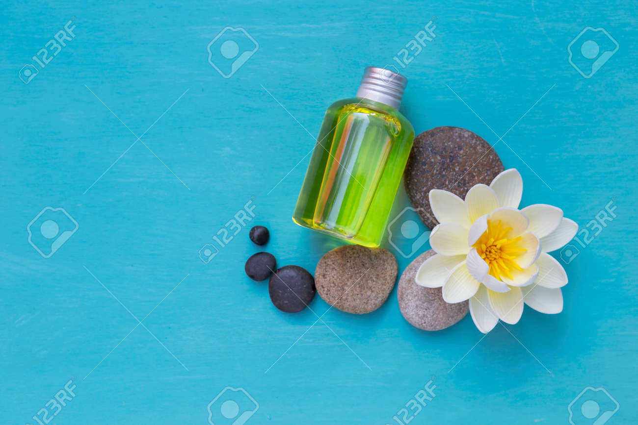 Spa Concept Background Oil Bottle With White Flower And Round