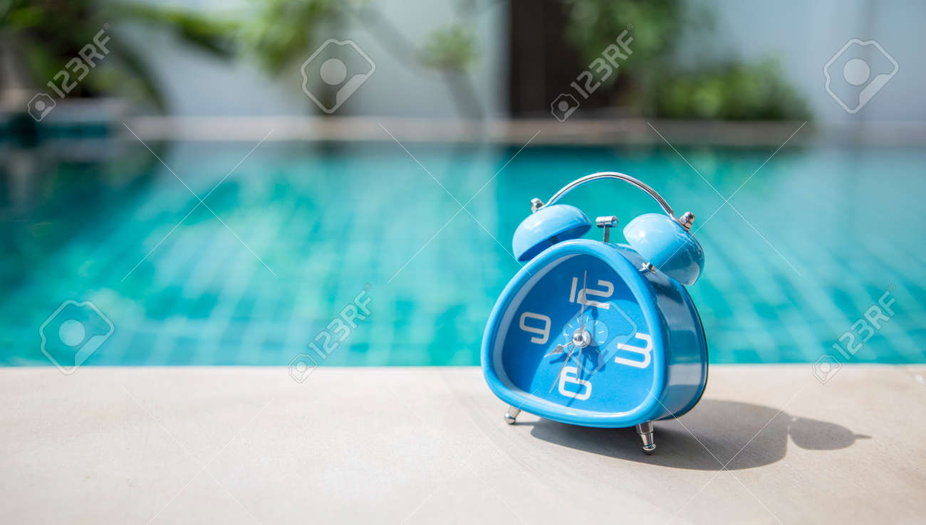 Outdoor Swimming Pool Clocks.Blue Clock On Swimming Pool Edge Morning Outdoor Day Light