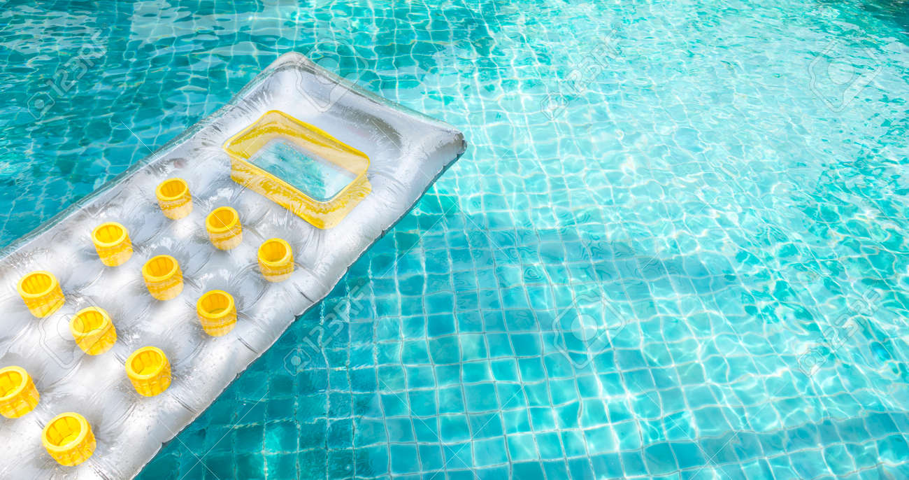 Summer concept, color swimming pool air mattress floating on..