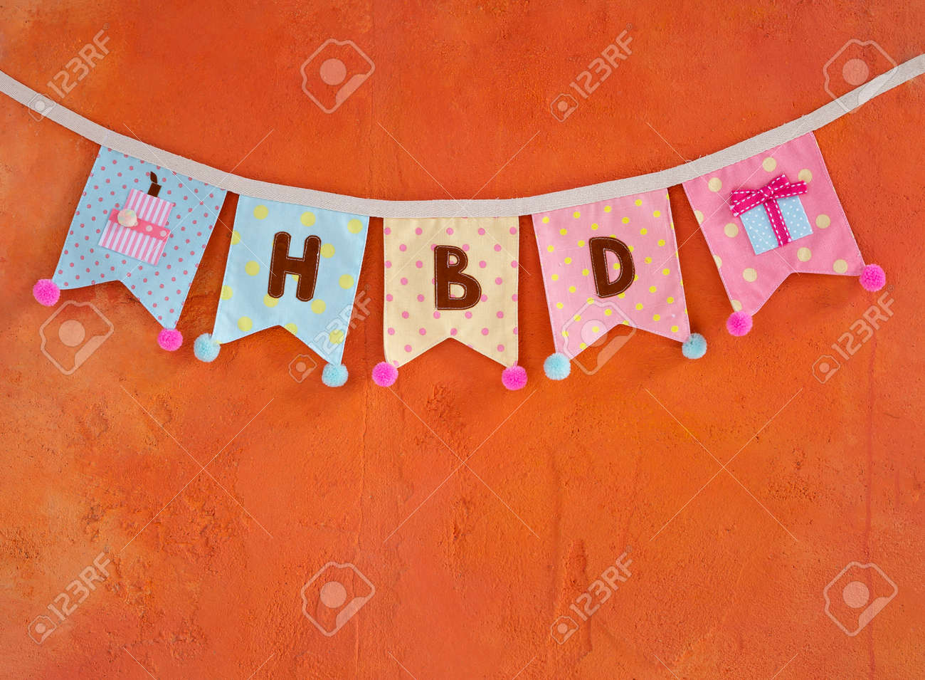 Design Birthday Party Flag Hanging On Orange Cement Wall Texture