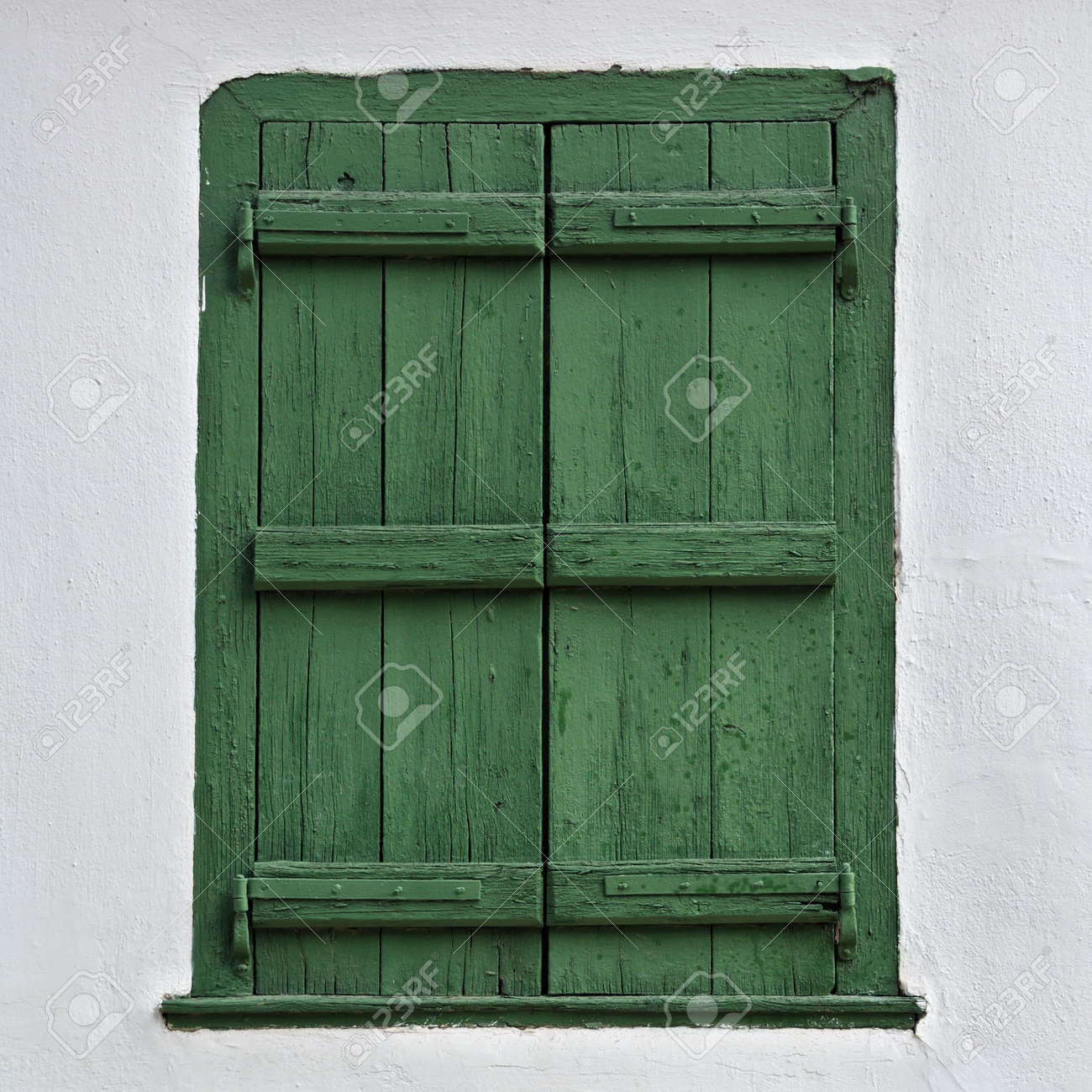 Green wooden window shutter and white wall. Stock Photo - 8553992