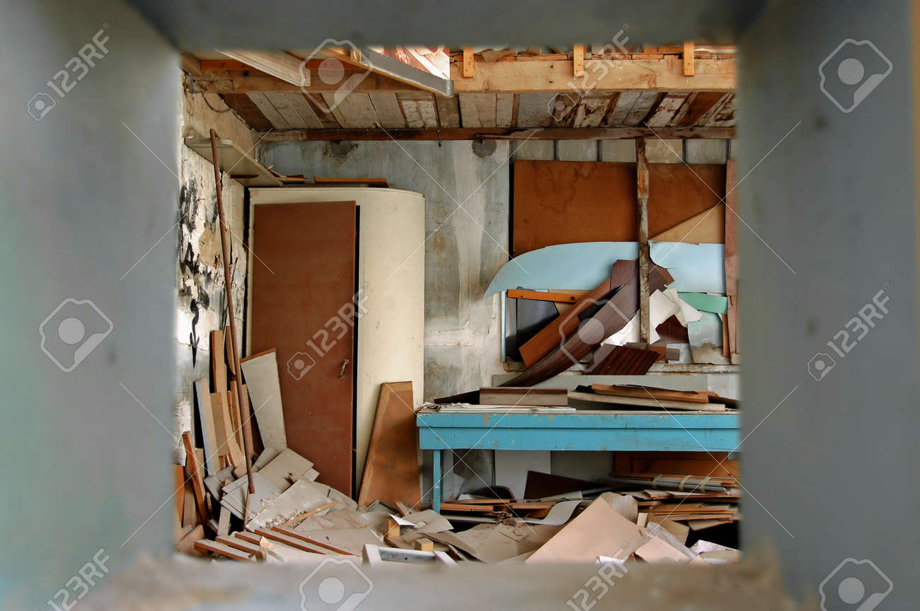 View to ramshackled room with boarded up window frame in abandoned factory. Stock Photo - 9217227