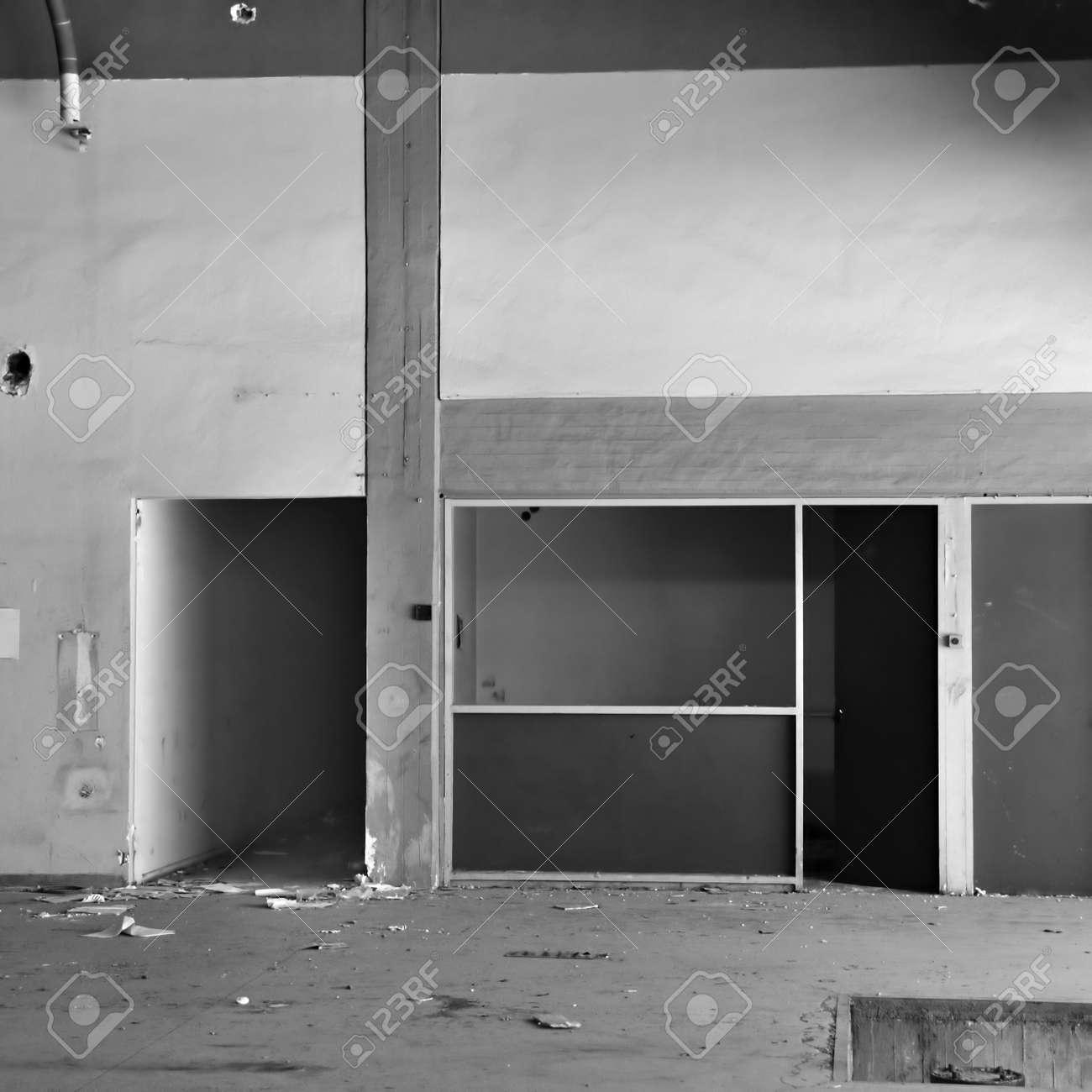 Empty room and concrete wall derelict factory interior. Black and white. Stock Photo - 13547380