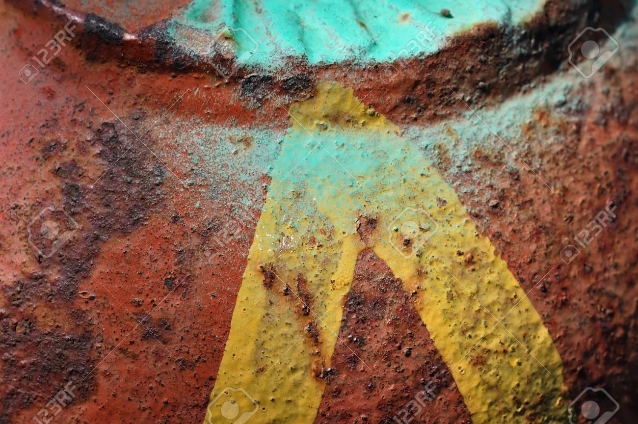 Yellow arrow on peeling rusty metal surface  Abstract iron background texture Stock Photo - 13547458