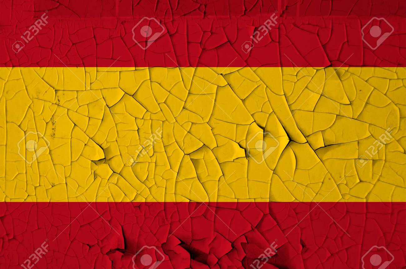Spanish national flag on peeling paint wall. Weathered grunge background. Stock Photo - 13897383