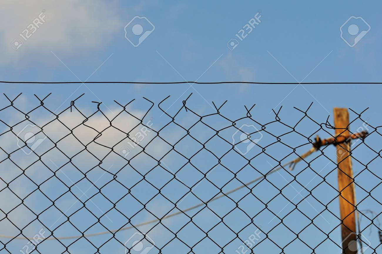 Chain link fence and blue sky urban background Stock Photo - 16761209