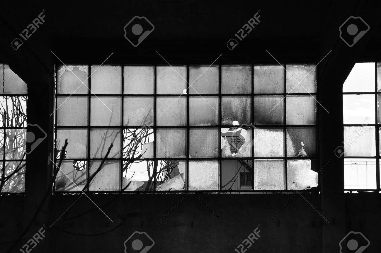 Broken windows and concrete wall in abandoned factory  Black and white Stock Photo - 18958601