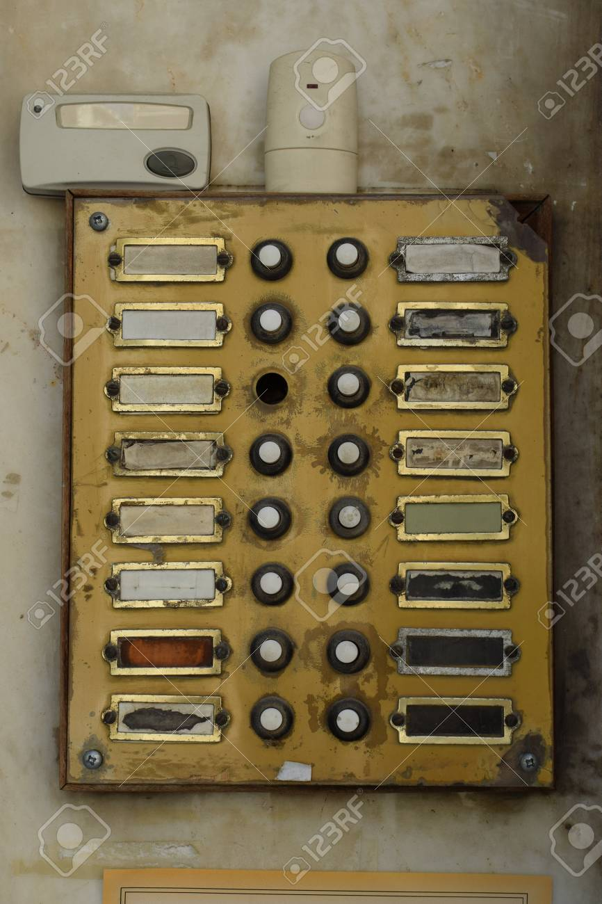 https://previews.123rf.com/images/sirylok/sirylok1708/sirylok170800011/83525604-old-weathered-doorbell-panel-in-apartment-building-grungy-door-bell-buzzer-with-broken-buttons-.jpg