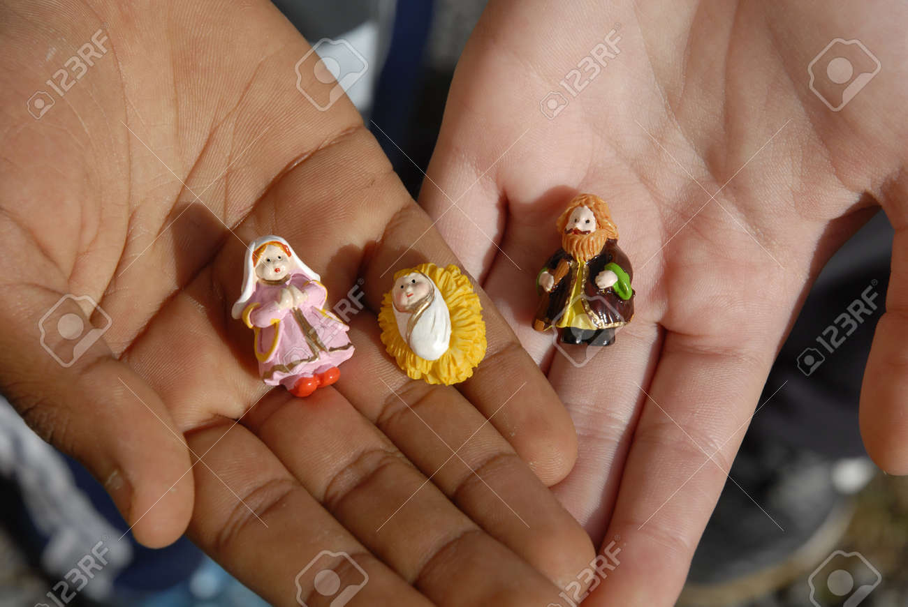 hands of two children with Christmas figurines Stock Photo - 11111871