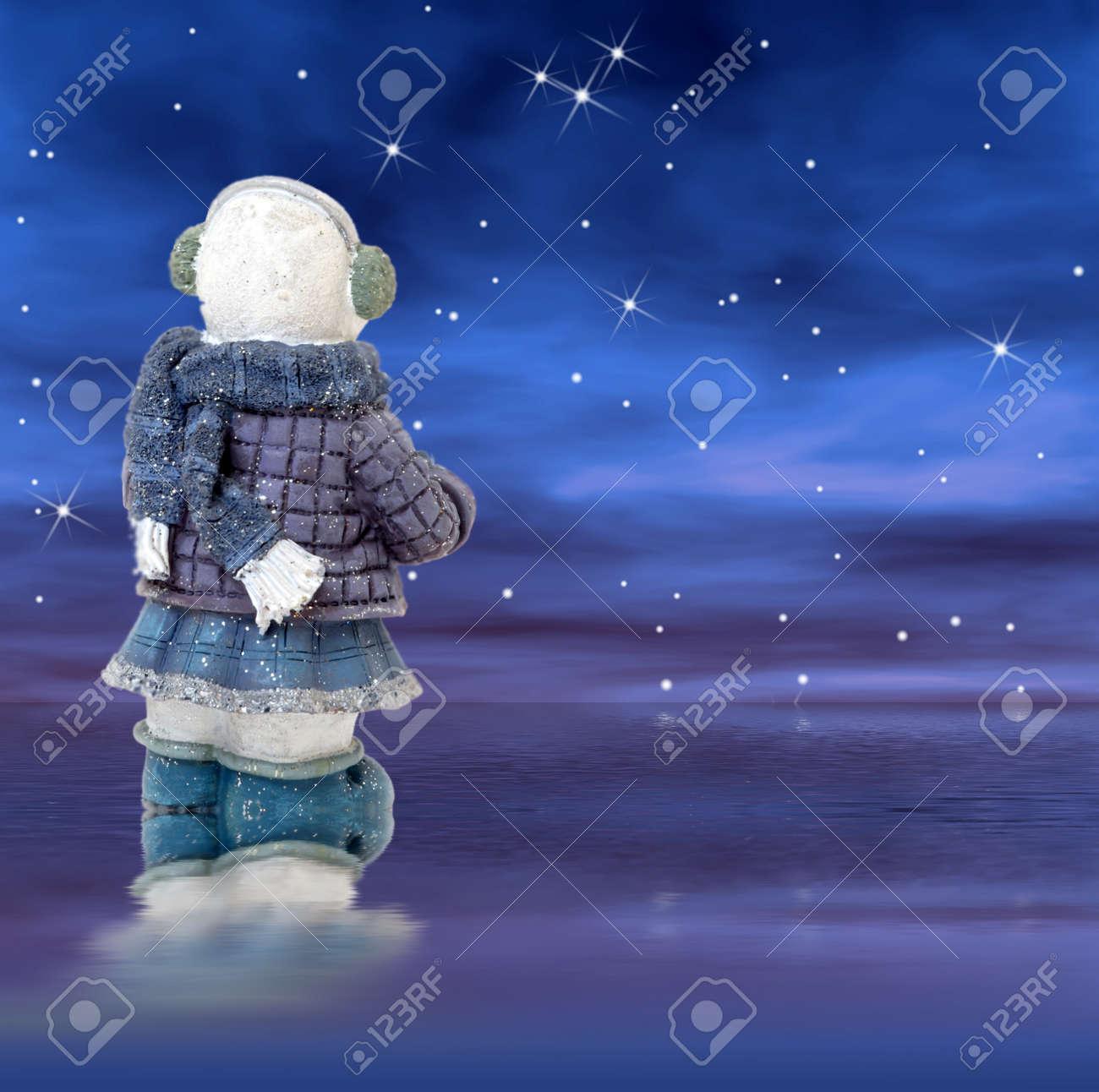 Snowman back facing the sky at night Stock Photo - 11688486
