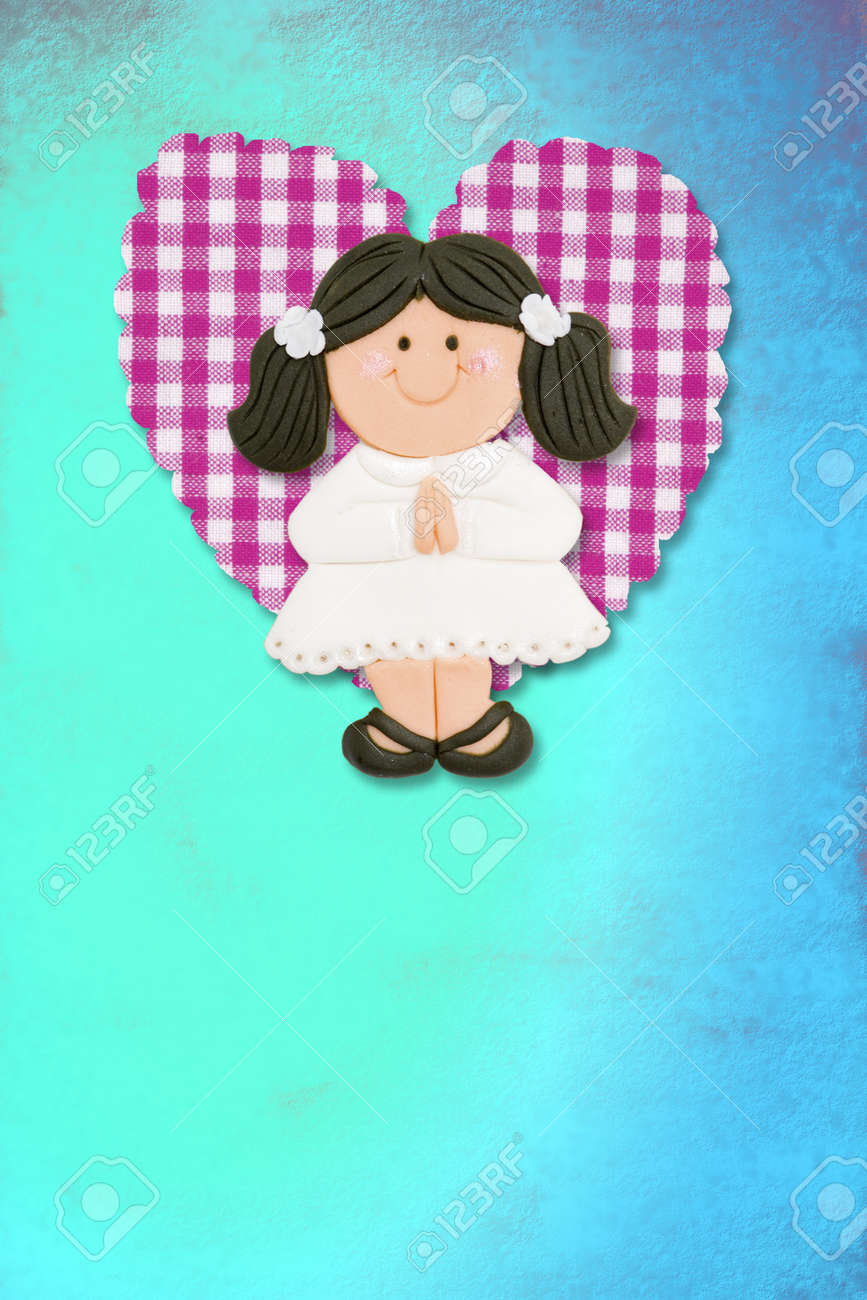 First Holy Communion Invitation Card, cute brunette girl on blue background Stock Photo - 12379775