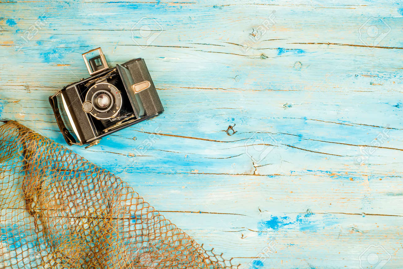 Summer Holidays Background Old Camera And Fishing Net On Rustic