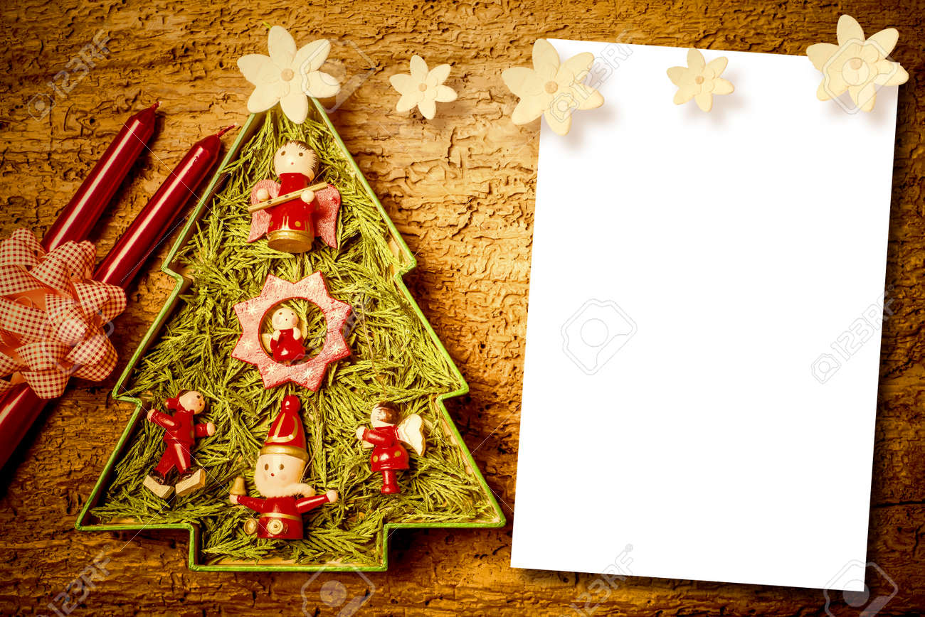 chtistmas letters, cute christmas tree, candles and flowers with