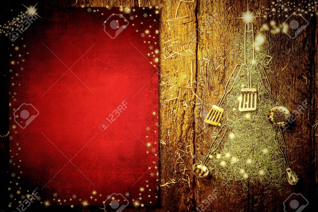 Background invite to write Christmas menu. Old kitchen utensils forming a Christmas tree and blank red paper on old wooden background. - 134710332