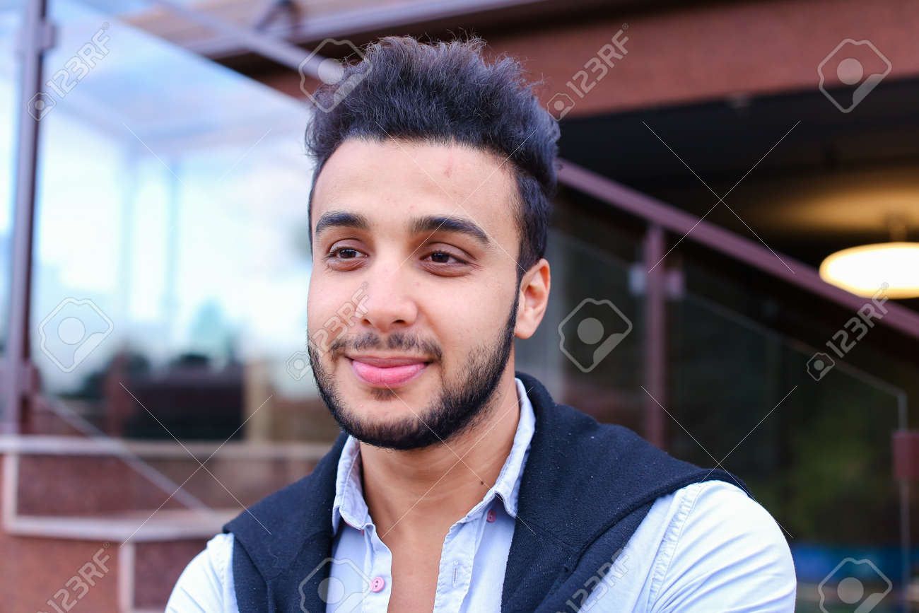 Portrait Of Beautiful Arab Guy Happy Young Man Smiling Big Smile And Looking In Camera