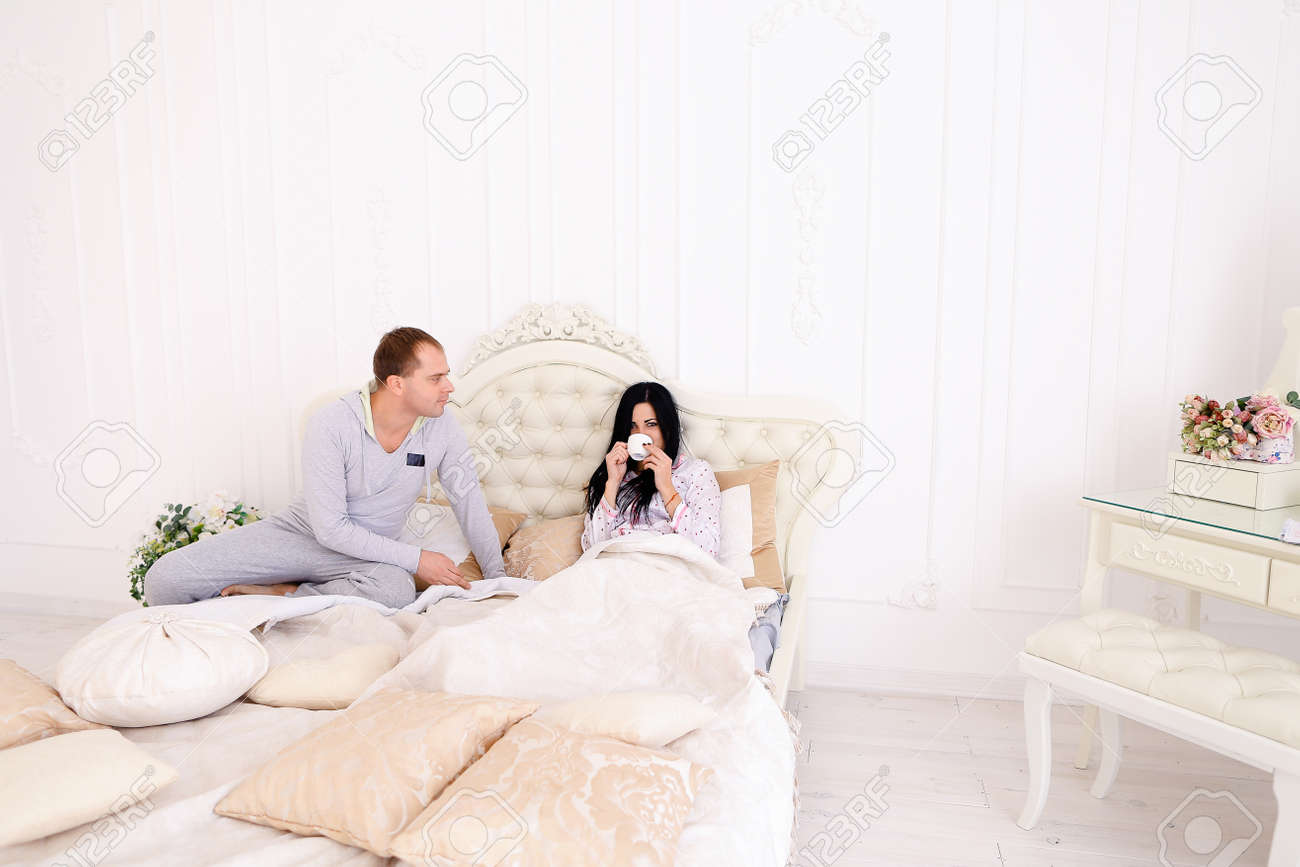 Thoughtful guy brought Coffee to girl bed for Good morning  Husband,