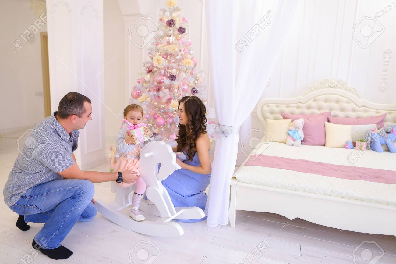 Beautiful Young Mom And Dad Handed Gifts Female Child Stock Photo ...