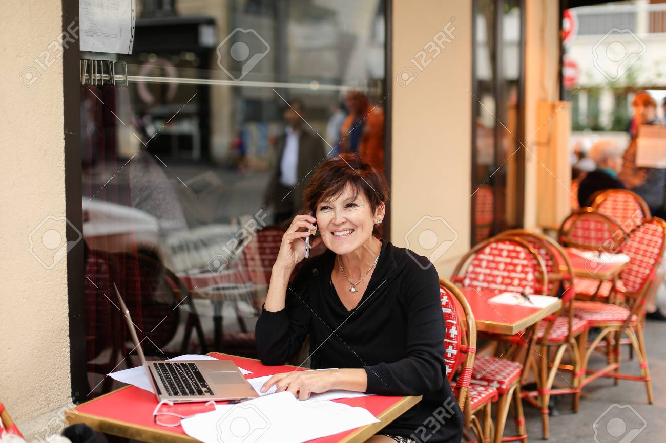 female journalist working hard for long time at laptop for important