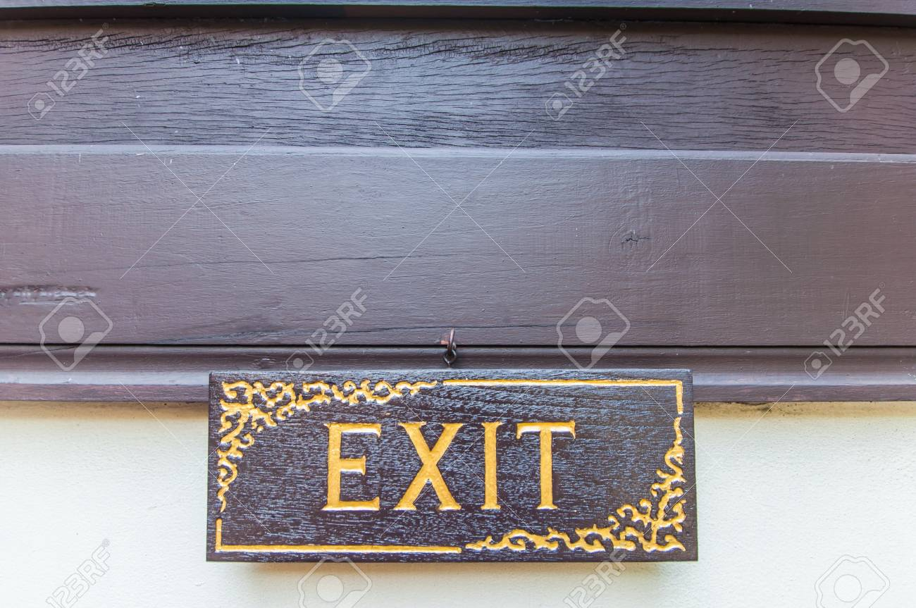 Exit signs are made   of wood and gold lettering Stock Photo - 17604939
