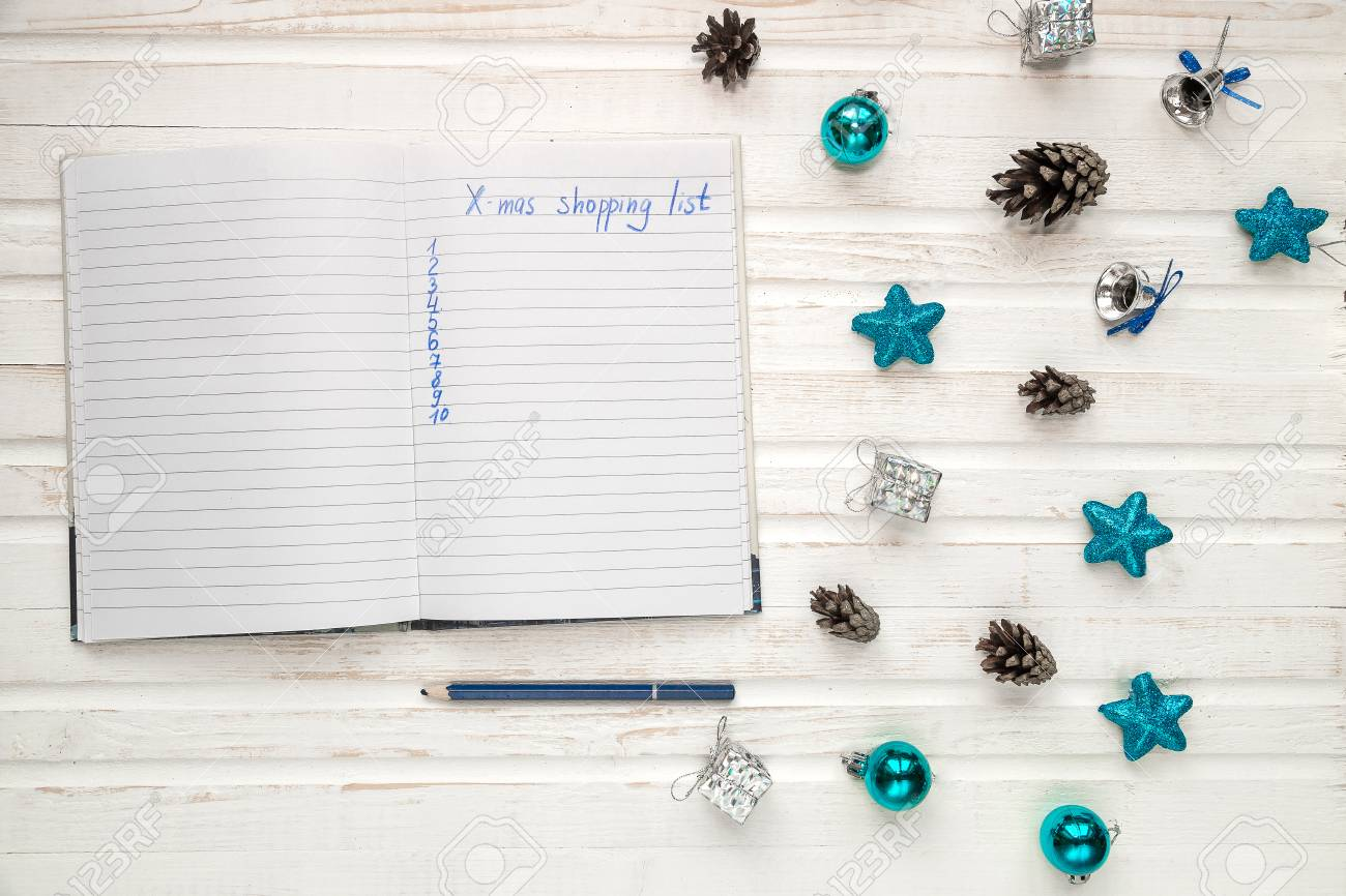 Christmas Shopping List On White Wooden Background Holiday