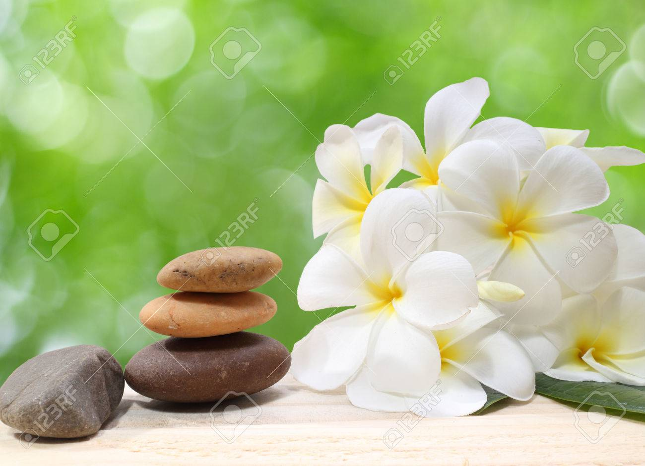 Zen spa concept background - Zen massage stones with frangipani plumeria flower - 40644780