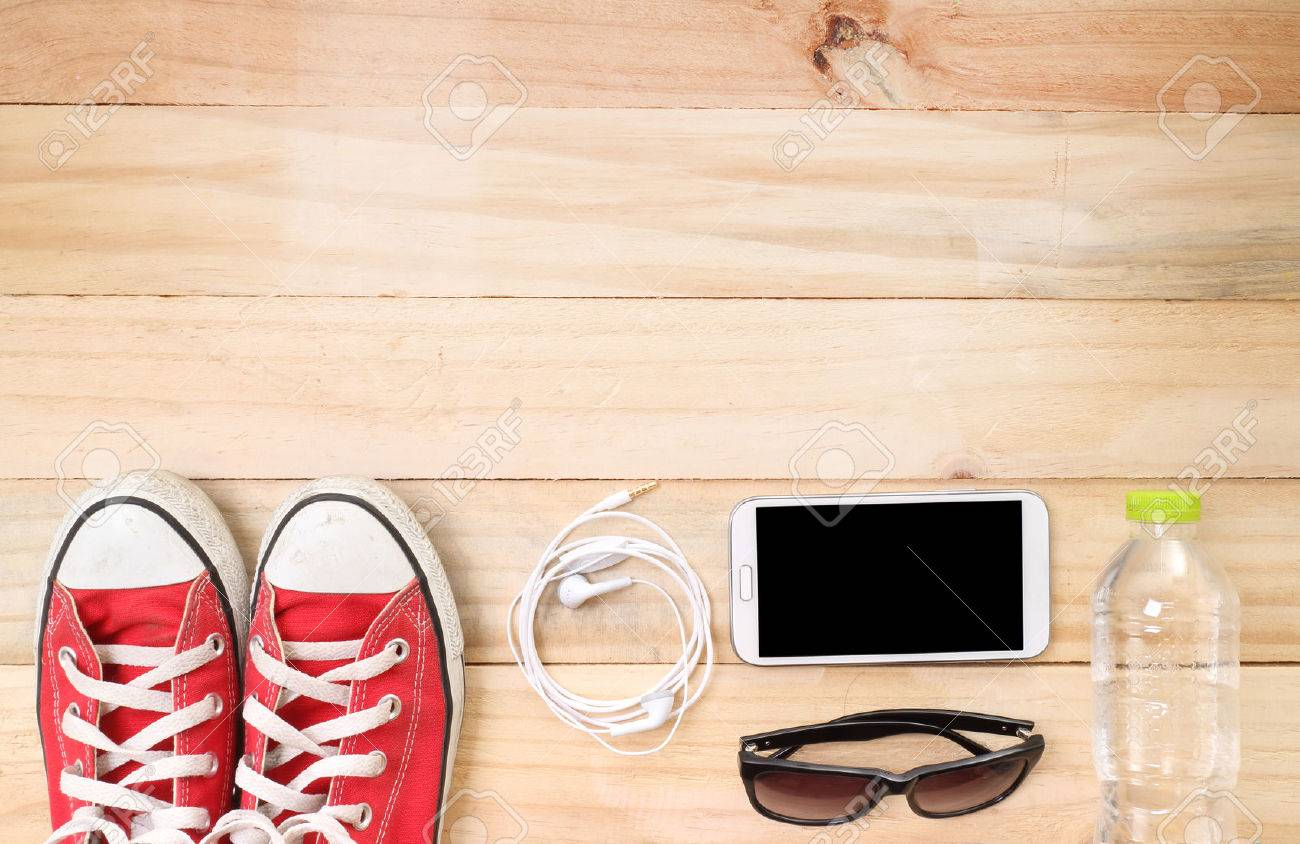 Outfit of traveler, student, teenager, young woman or guy. Overhead of essentials for modern young person. Different objects on wooden background. - 41293765